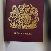 An image showing a British passport that has been altered, where the word passport is changed with Brexit stories.